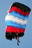 Parachutist on blue sky extreme sport — Stock Photo