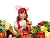 Little girl cook peeling potatoes — Stock Photo