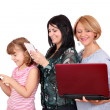 Three generations girls with smart phone tablet and laptop — Stock Photo