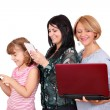 Three generations girls with smart phone tablet and laptop — Zdjęcie stockowe
