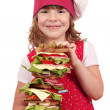 Beautiful little girl cook with tall sandwich — Stock Photo
