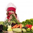 Beautiful little girl cook with different vegetables — Stock Photo
