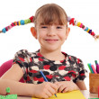 Stock Photo: Happy little girl with pigtails drawing