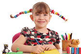 Happy little girl with pigtails drawing — Foto Stock