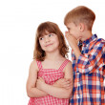 Boy whispering a secret little girl on white — Stock Photo #39689803