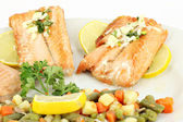 Salmon with lemon and vegetables — Stock Photo