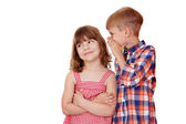 Boy whispering a secret little girl on white — Stock Photo