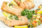 Seafood salmon with lemon and vegetables — Stock Photo