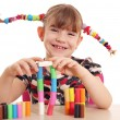 Happy little girl play with plasticine — Stock Photo #40213463