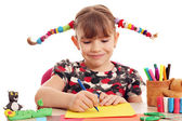 Beautiful little girl with pigtails drawing — Stock Photo