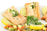 Seafood salmon with salad and lemon — Стоковое фото