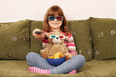 Little girl and teddy bear with 3d glasses watching tv — Stock Photo