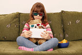 Little girl and teddy bear with 3d glasses watching movie on tab — Stock Photo