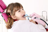 Little girl with open mouth during drilling treatment at the den — Stock Photo