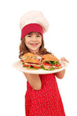 Happy little girl cook with sandwiches — Stock Photo