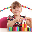 Happy little girl play with colorful plasticine — Stock Photo
