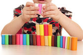 Child fun and play with plasticine — Stock Photo