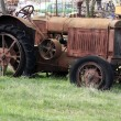 Old rusty tractor on field — Stock Photo #42776477