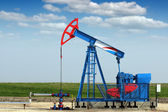 Oil industry pump jack on oilfield — Stock Photo