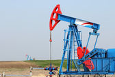 Oilfield with pump jack oil industry — Stock Photo