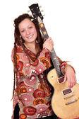 Happy girl with dreadlocks hair and guitar — Stock Photo