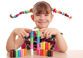 Beautiful little girl play with plasticine — Stock Photo