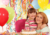 Happy mother and daughter birthday party — Stock Photo