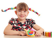 Happy little girl with snail plasticine figure — Stock Photo