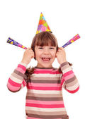 Happy little girl with trumpets and hat birthday party — Stock Photo