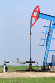 Oil pump jack and valve with pipeline — Stock Photo