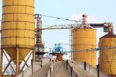 Concrete factory with crane industry zone — Стоковое фото
