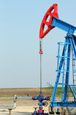 Two oil pump jack on field — Stock Photo