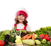 Happy little girl cook with vegetables — Stok fotoğraf