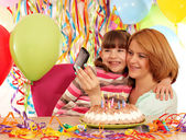Mom and daughter take pictures at a birthday party  — Stock Photo