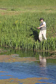 Fisherman on river leisure and recreation — Stock Photo