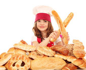 Happy little girl cook with bread buns and pretzels — Foto Stock