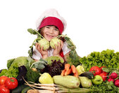 Happy little girl cook with vegetables — Stock Photo