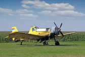 Crop duster airplane on airfield — Stock Photo