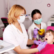Dentist nurse and little girl patient — Stock Photo #50862447