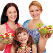 Women teenage and little girl hold salad — Stock Photo #51097933