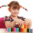Happy little girl play with plasticine — Stock Photo #51462269