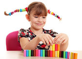 Happy little girl play with plasticine — Stock Photo