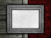 Picture frame on rough wall and wood background — Zdjęcie stockowe