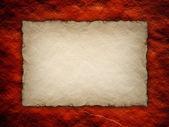 Hoja de papel en el fondo de la pared roja — Foto de Stock