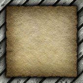 Old crumpled paper sheet on wood background — Stock Photo