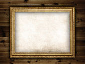 Picture frame on planks background — Stock Photo