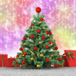 Christmas tree and gifts on a colored background — Stock Photo