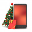 Christmas tree, gift and cell phone — Stock Photo
