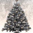 Silver Christmas tree on a gray background — Stock Photo
