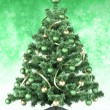 Royalty-Free Stock Photo: Christmas tree on green background